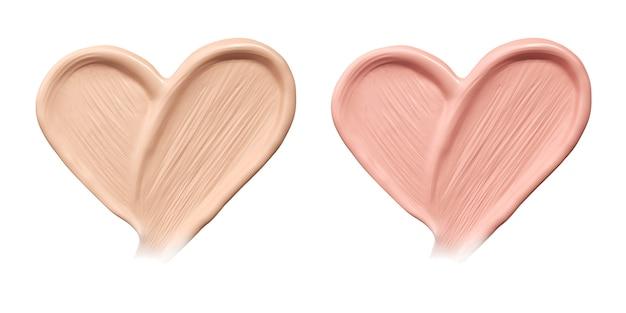 Esfregaços cosméticos de fundação em forma de coração.