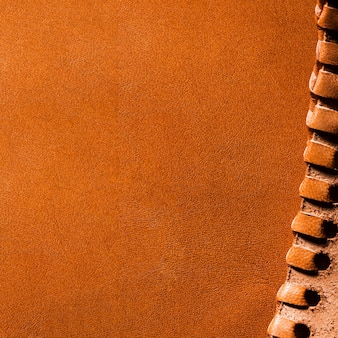 Espaço para cópia em couro laranja em close-up extremo