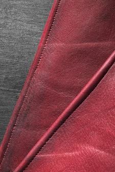 Espaço para cópia em couro vermelho vinho de qualidade em close-up