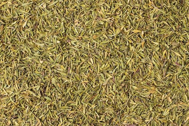 Especiarias secas de tomilho como pano de fundo, textura de tempero natural