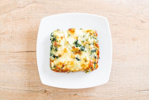 Espinafre cozido com queijo