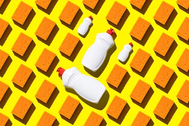 Esponjas e detergente de lavar louça de padrão uniforme laranja