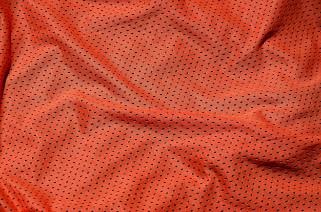 Esporte vestuário tecido textura de fundo, vista de cima da superfície têxtil de pano vermelho