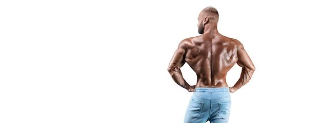 Esportista posando isolado no branco em jeans. vista traseira