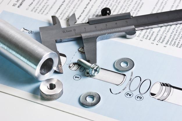 Esquema mecânico e pinças com detalhes