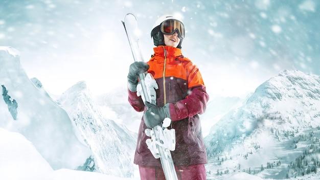 Esquiadora em pé com o céu em uma mão no fundo de uma bela paisagem montanhosa. inverno, esqui, neve, férias, esporte, lazer, conceito de estilo de vida