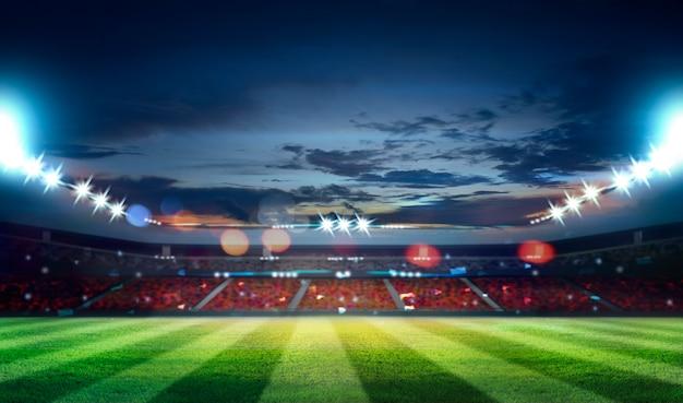 Estádio de futebol com iluminação, grama verde e céu noturno