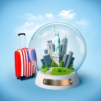 Estátua da liberdade e edifícios na esfera de vidro