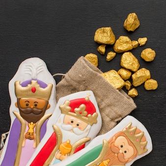 Estatuetas de biscoito realeza com minério de ouro