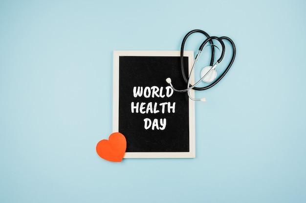 Estetoscópio médico e de saúde do dia mundial da saúde e texto dia mundial da saúde em uma moldura em azul