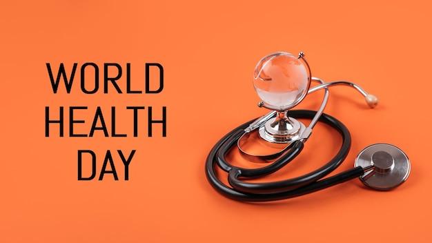 Estetoscópio médico e de saúde do dia mundial da saúde e vidro global em espaço de cópia de fundo laranja