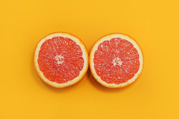 Estilo minimalista, layout criativo laranjas em fundo amarelo