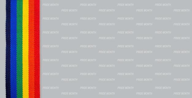 Estilo vertical da fita de listra do arco-íris e mês do orgulho, padrão de palavra isolado em fundo cinza. conceito lgbt com cores do orgulho e faixa da bandeira do arco-íris. fundo de banner lgbt.