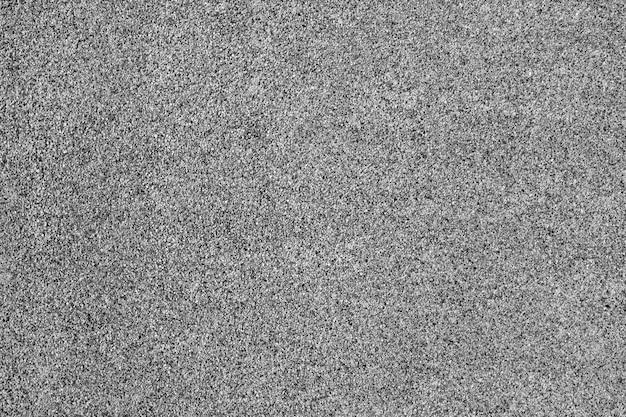 Estrada de asfalto cinza para plano de fundo ou textura. plano de fundo texturizado natural.