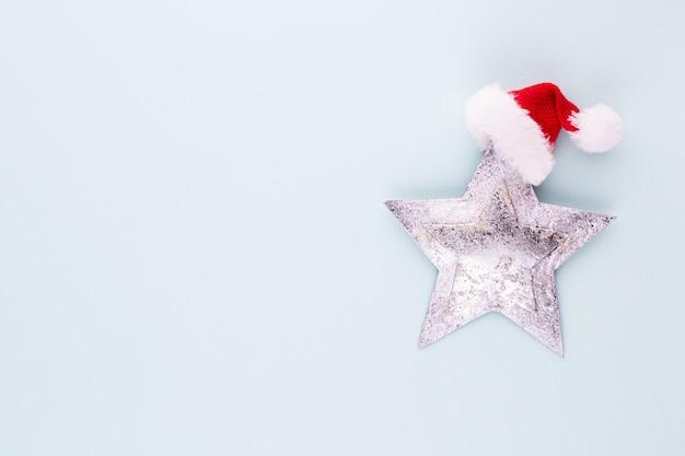 Estrela de natal, decoração em fundo de cor pastel. conceito mínimo de natal ou ano novo.