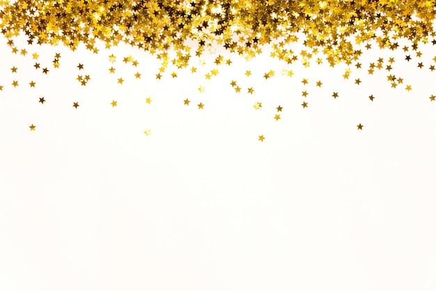 Estrela em forma de fundo de lantejoulas douradas.