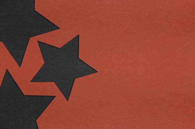 Estrela negra com textura de papel vermelho