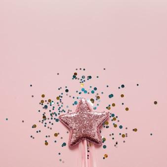 Estrela rosa close-up e vista superior de glitter