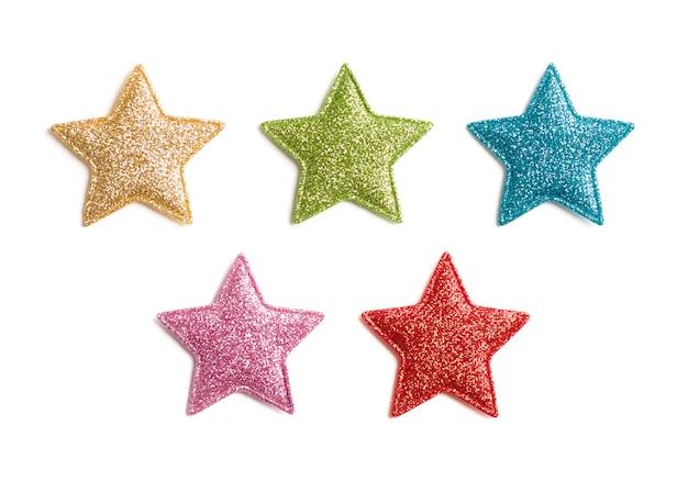 Estrelas brilham em branco.