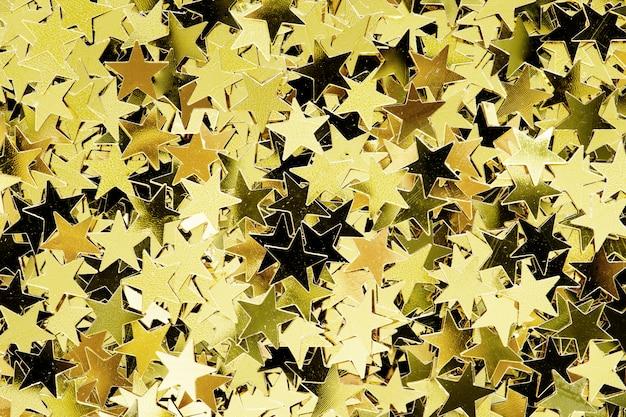Estrelas de ouro modelado fundo