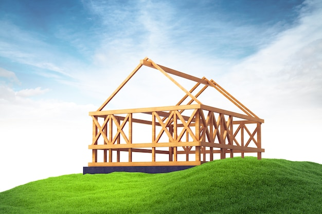 Estrutura de madeira para construção de casa nova na grama no fundo do céu