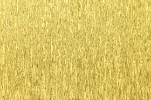 Estrutural do fundo dourado de papel ondulado ondulado, close up.