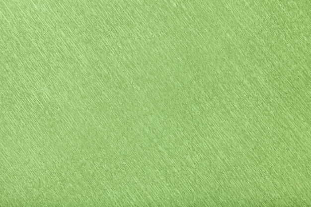 Estrutural do fundo verde de papel ondulado ondulado, close up.