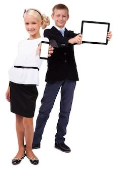 Estudante, com, um, tabuleta, e, um, schoolgirl, com, um, telefone móvel