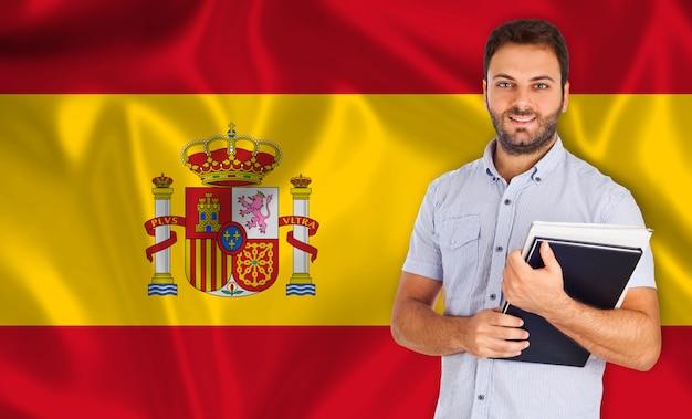 Estudante, sorrindo, sobre, bandeira espanhola