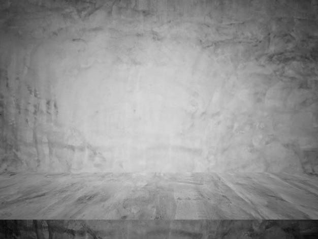 Estúdio de mesa e prateleiras de cimento preto e fundo escuro da sala de exposições para produtos atuais