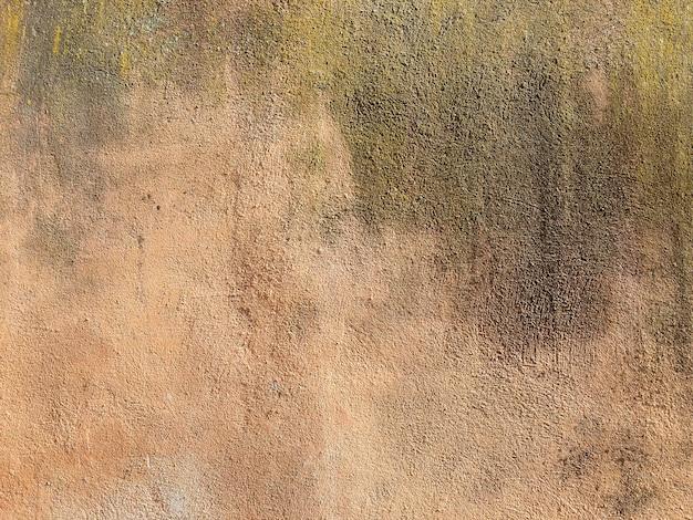 Estuque na parede de tijolos na itália. fundo de textura de parede