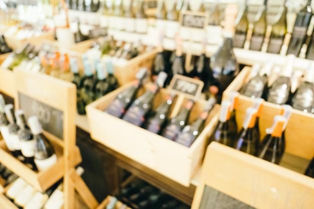 Esvaziamento abstrato e loja de vinhos defocused