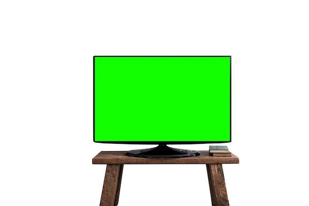 Esvazie a tela verde tv plana no suporte de madeira