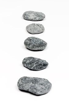 Et de pedras cinzentas planas do mar