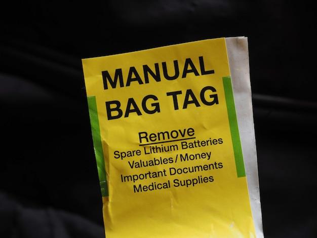 Etiqueta de bagagem manual