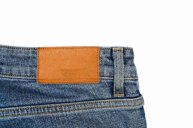 Etiqueta traseira em jeans, close-up.