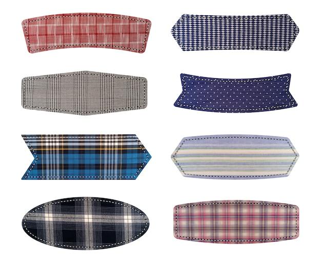 Etiquetas têxteis. etiquetas de textura de tecido isoladas em branco