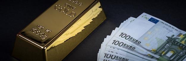 Euro dinheiro e barra de ouro. notas. dinheiro. conta. lingote. barras.