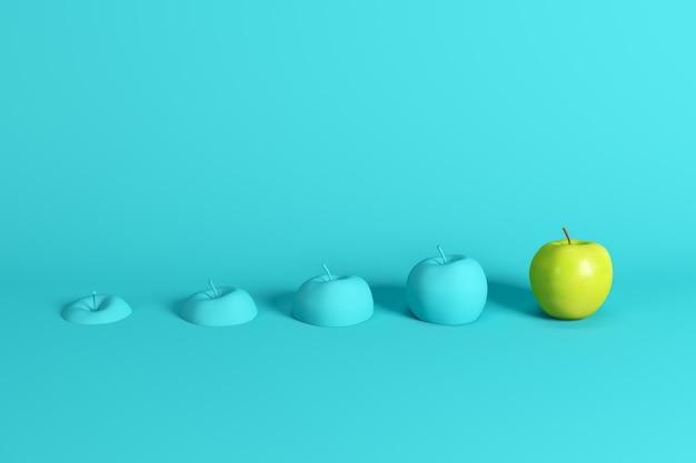 Excelente maçã verde fresca e fatias de maçã pintado em azul sobre fundo azul