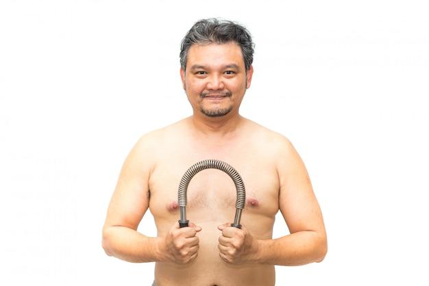 Exercício asiático do homem usando a barra do poder da mola