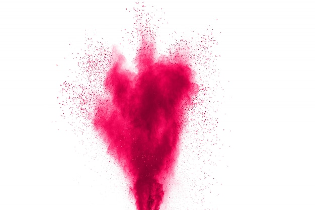 Explosão cor-de-rosa abstrata do pó no fundo branco. congele o movimento do pó rosa espalhado.