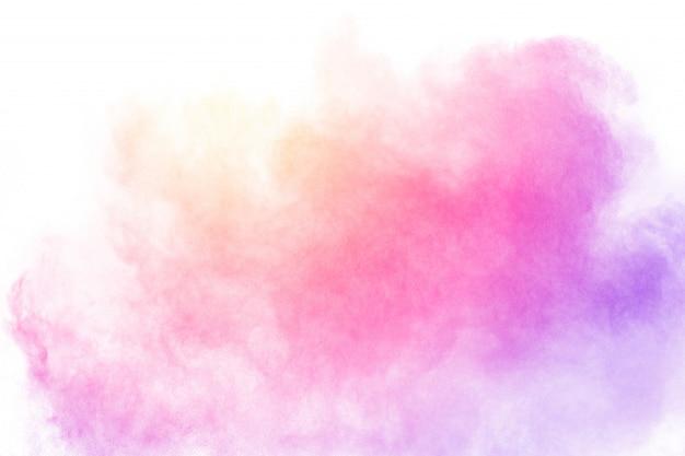 Explosão de partículas multicoloridas em fundo branco.