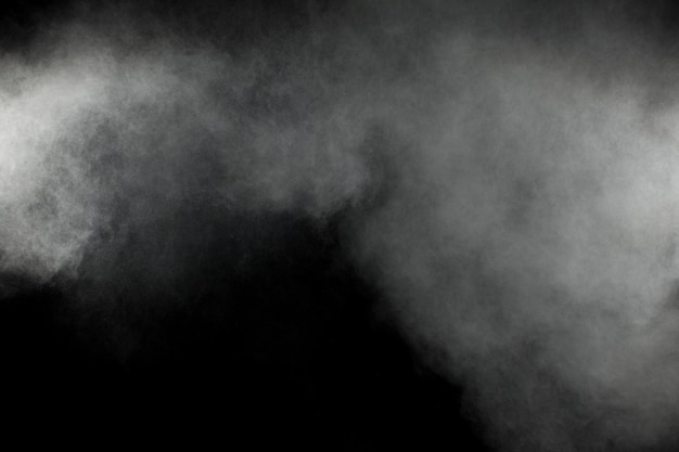 Explosão de pó branco abstrato sobre um fundo preto