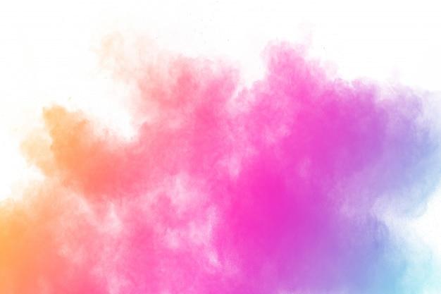 Explosão de pó colorido. salpicos de partículas de poeira de cor pastel.
