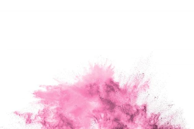 Explosão de pó-de-rosa. pó rosa espirrando. partículas coloridas lançadas