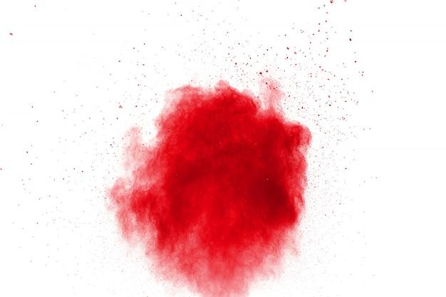 Explosão de pó vermelho. movimento de resfriamento de salpicos de partículas vermelhas.
