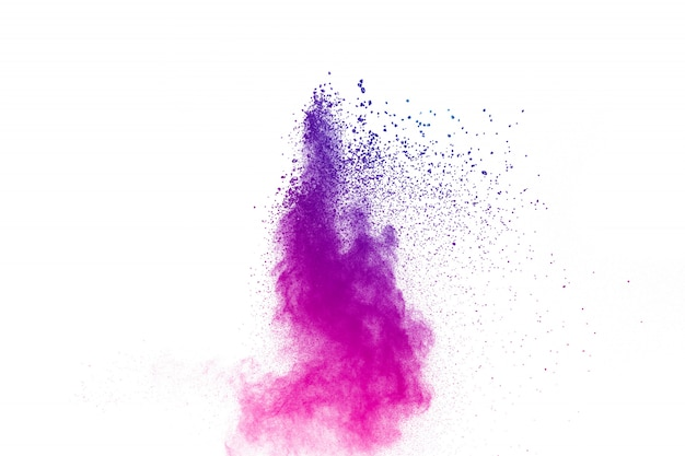 Explosão roxa do pó no fundo branco.