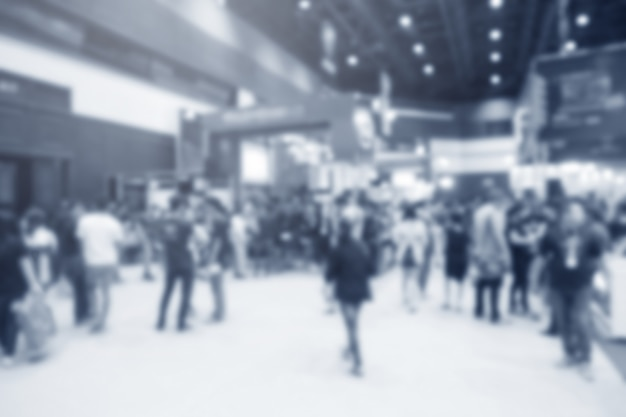 Exposição de evento abstrata turva com fundo de pessoas