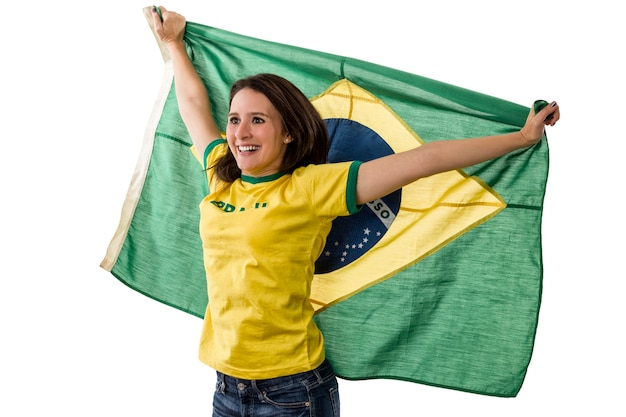 Fã brasileira comemorando em um espaço em branco.