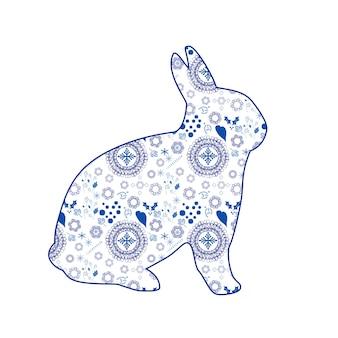 Faça uma silhueta do coelho em um padrão sem costura ikattecido étnico motivo ornamental para a página de teia de tecido